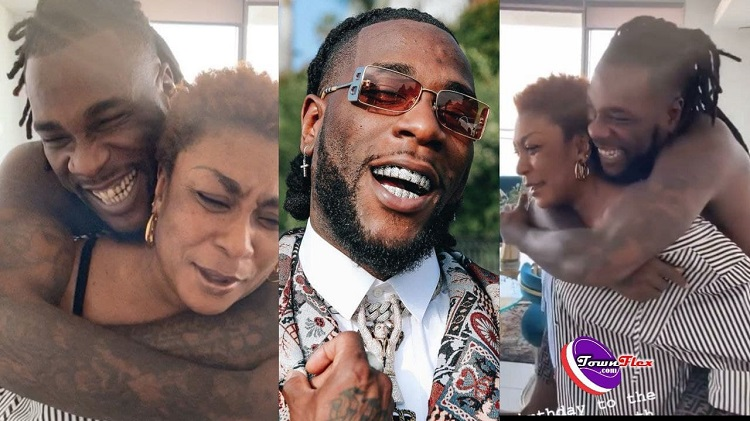 Burna Boy 30th Birthday: Watch Moments As Mama Carry Son On Her Back During Celebration (Watch Video)
