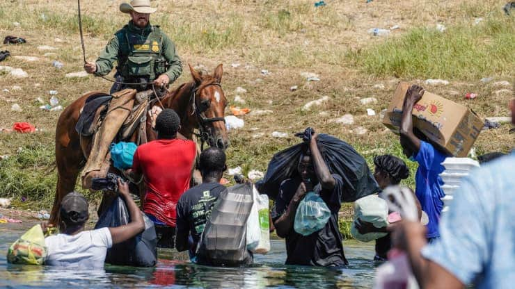 US border agents use horses and whips to move Haitian migrants seeking protection